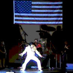 on_stage_with_flag_elvis_ringersen